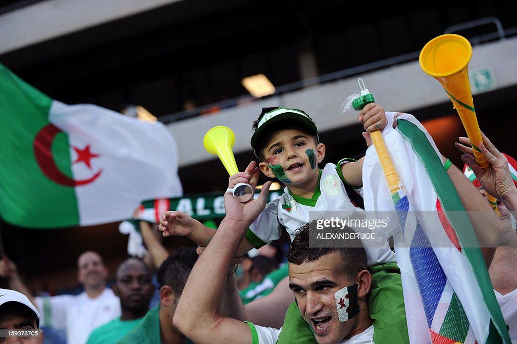 Algerian fans cheer during a friendly football match between South Africa's Bafana Bafana and Algeria in Soweto on January 12 , 2013, ahead of the 2013 African Cup of nation that will take place in South Africa from January 19 to February 10.