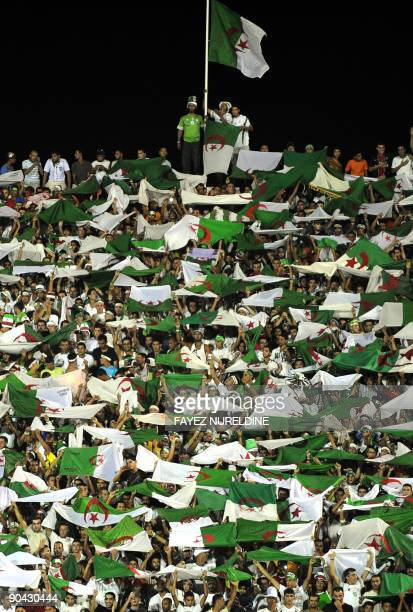 Algerian fans wave national flags as they celebrate their team's goal during their 10 victory over Zambia in the 2010 World Cup African zone group C...