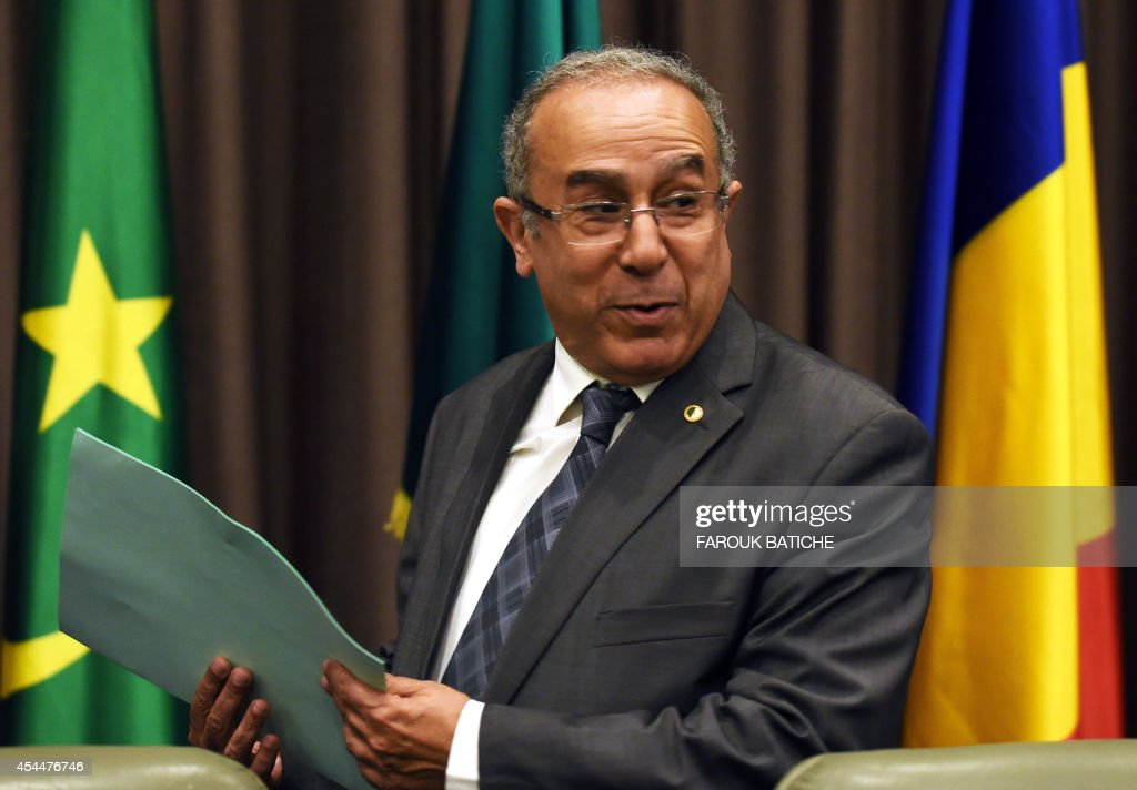 Algerian Foreign Affairs Minister Ramtane Lamamra attends the opening of peace talks on September 1, 2014 in Algiers between the Malian government and armed rebels, which are the second round of negotiations since July aimed at clinching a lasting peace agreement. The Bamako government and six rebel groups, mostly Tuareg but also including Arab organisations, are seeking to resolve a decades-old conflict that created a power vacuum in the desert north that was exploited by Al-Qaeda. AFP PHOTO / FAROUK BATICHE