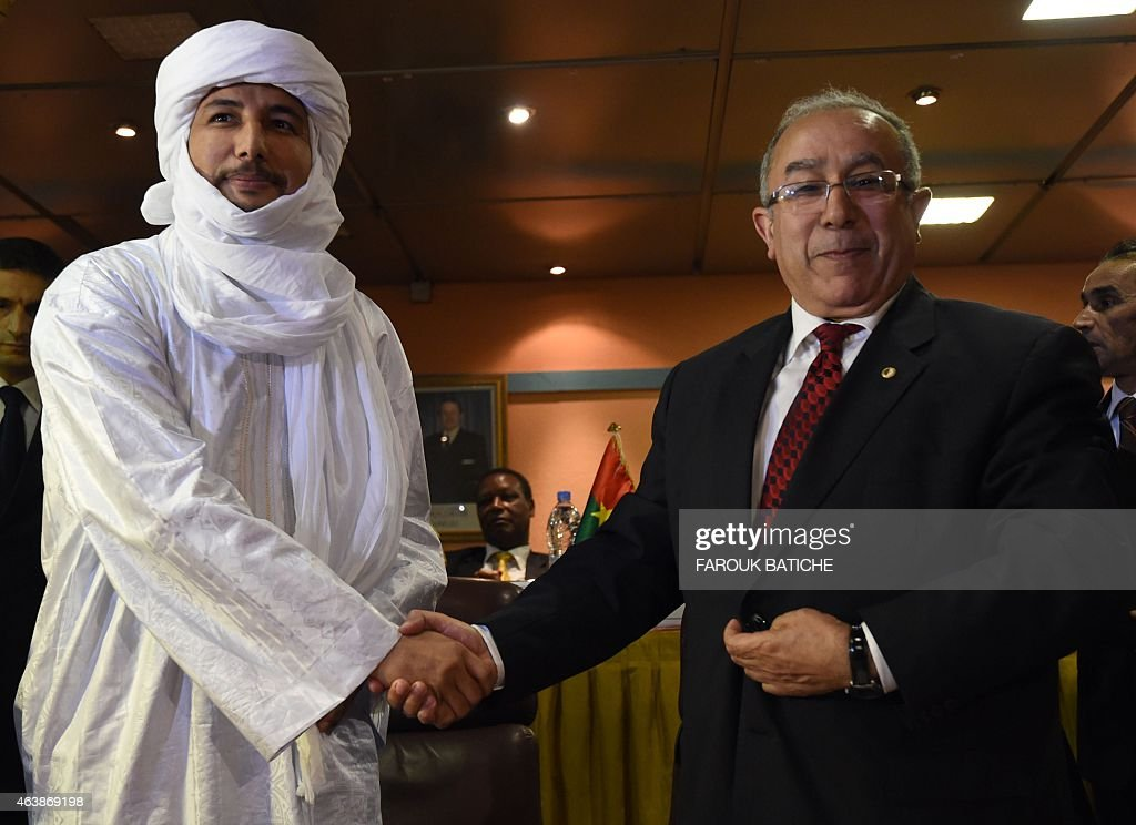 Algerian Foreign Minister <a gi-track='captionPersonalityLinkClicked' href=/galleries/search?phrase=Ramtane+Lamamra&family=editorial&specificpeople=5486120 ng-click='$event.stopPropagation()'>Ramtane Lamamra</a> (R) shakes hands with Secretary general of Mali's Tuareg Tuareg National Movement for the Liberation of Azawad (MNLA) group Bilal Ag Acherif after the signing of a peace agreement between the Malian government and armed groups in the north of Mali, on February 19, 2015 in Algiers, following rounds of peace talks. The Malian government and six armed movements from the north conducted four rounds of talks since July 2014 in Algiers to restore peace in northern region of Mali, which remains unstable despite the of launch of French and international military intervention in 2013 against Islamist rebels. AFP PHOTO / FAROUK BATICHE