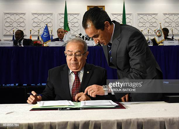 Algerian Foreign Minister Ramtane Lamamra signs a peace agreement as part of mediation talks between the Malian government and some northern armed...