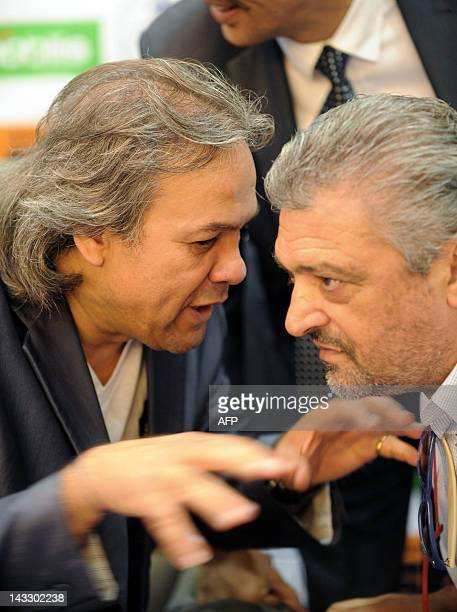 Algerian former football player and UNESCO Goodwill Ambassador Rabah Madjer speaks with Italian former football player Alessandro Altobelli during a...