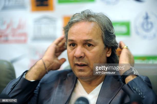 Algerian former football player and UNESCO Goodwill Ambassador Rabah Madjer gestures during a press conference on April 23 2012 in Algiers ahead of a...