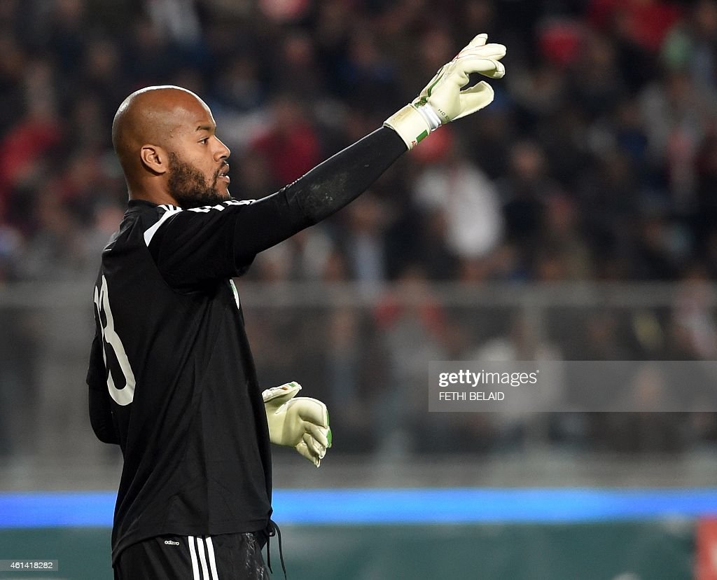 Algerian goalkeeper Rais Mbolhi reacts during a freindly soccer match between Tunisia and Algeria on January 11, 2015 at Rades Olympic Stadium in Tunis.