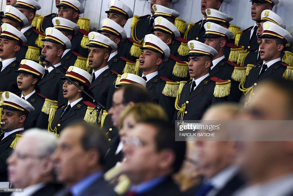Algerian honour guards sing the national anthem during a parliamentary session to adopt a package of constitutional reforms on February 7, 2016, in the capital Algiers. Algeria's parliament adopted the constitutional reforms that authorities say will strengthen democracy, but opponents doubt it will bring real change. The reforms are meant to address longstanding public grievances in the North African nation, and possibly to prepare for a smooth transition amid concerns over the health of 78-year-old President Abdelaziz Bouteflika. / AFP / Farouk Batiche