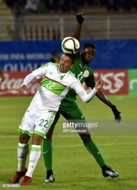 Algerian Ismael Bennacer vies with Nigerian Wilfred Ndadi during a World Cup 2018 qualifying football match between Algeria and Nigeria at...