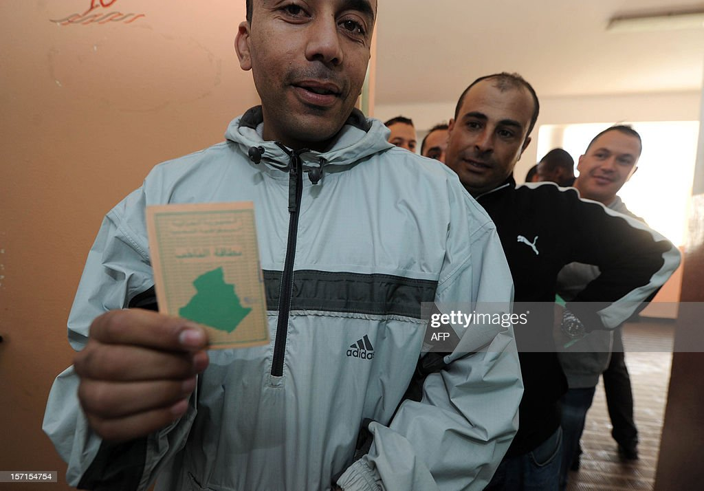 Algerian men wait to vote at a polling station in Algiers during local elections on November 29, 2012. Algeria's ruling party is eyeing a landslide victory in local elections, with numerous opposition groups warning of fraud in a poll that could struggle to mobilise a disaffected electorate. AFP PHOTO/FAROUK BATICHE