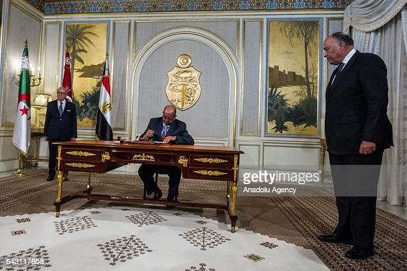 Algerian Minister for Maghreb and Africa Affairs Abdel Kadir Mesahil signs a memorandum of understanding as he gathers with Tunisian President Beji...