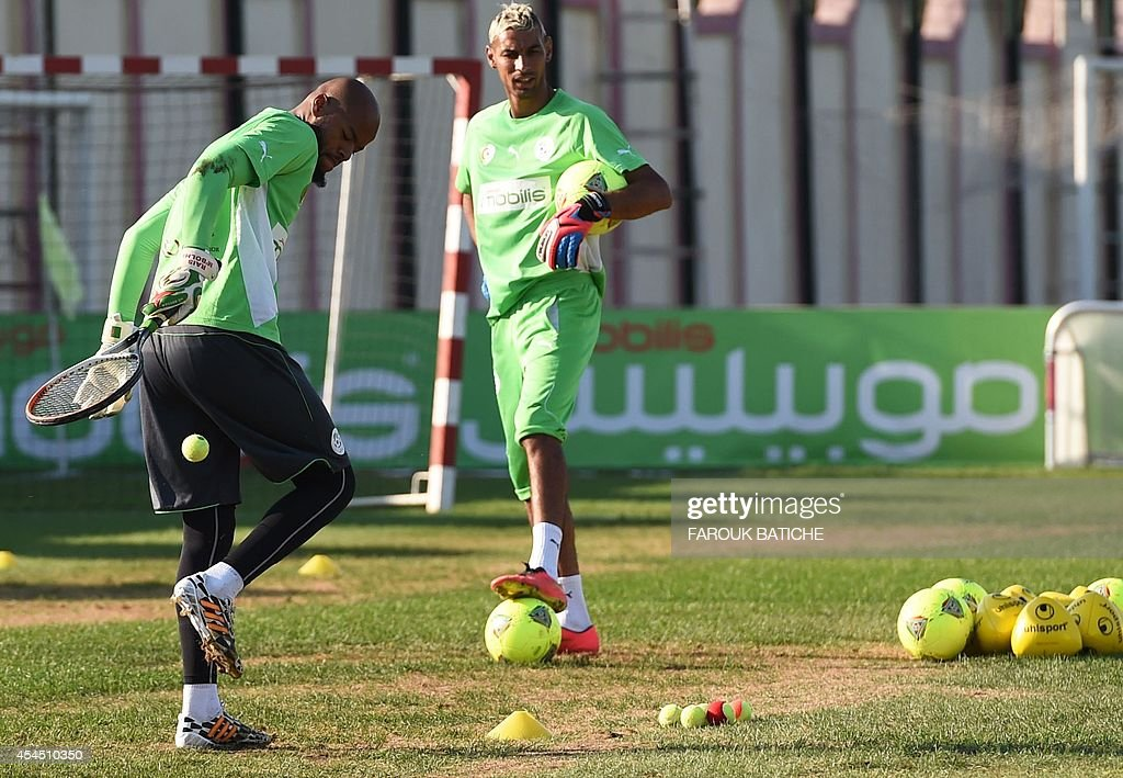 Algerian national football team goalkeeper Raïs M'Bolhi plays with a tennis ball and a racket during a training session at the Sidi Moussa centre in Algiers, on September 2, 2014. The Algerian Football Federation announced in a statement that Gourcuff had signed 'a contract with objectives including the Africa Cup of Nations in 2015 and 2017 and the 2018 World Cup.' Former Lorient coach Gourcuff, 59, will also coach the A team, made up exclusively of locally-based players.