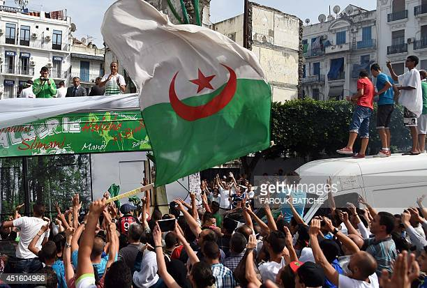 Algerian national team players are greeted by fans upon their return from the 2014 FIFA World Cup in Brazil on July 2 in the capital Algiers...