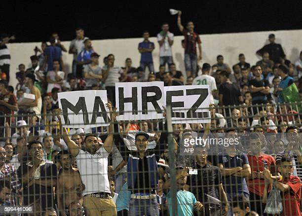 Algerian national team's supporters hold placards reading the name of Algerian player Mahrez during the 2017 African Cup of Nations qualifying...