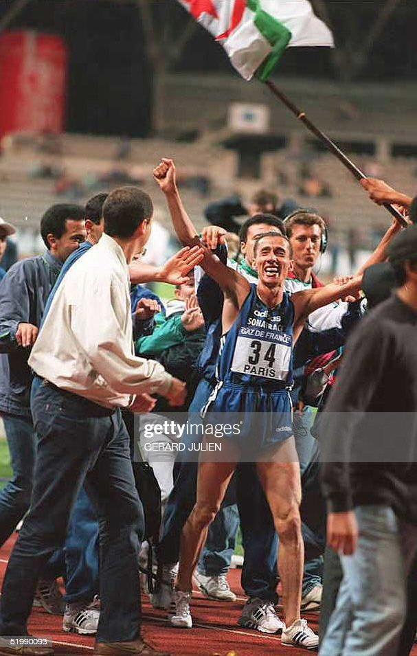 Algerian Nourredine Morceli is surounded by supporters after setting a new 2000meter world record with a time of 4 minutes 4788 seconds at the IAAF...
