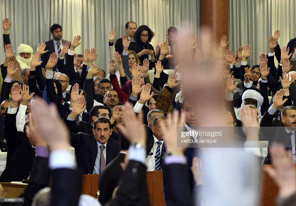 Algerian parliamentarians vote on a package of constitutional reforms on February 7, 2016, in the capital Algiers. Algeria's parliament adopted the constitutional reforms that authorities say will strengthen democracy, but opponents doubt it will bring real change. The reforms are meant to address longstanding public grievances in the North African nation, and possibly to prepare for a smooth transition amid concerns over the health of 78-year-old President Abdelaziz Bouteflika. / AFP / Farouk Batiche