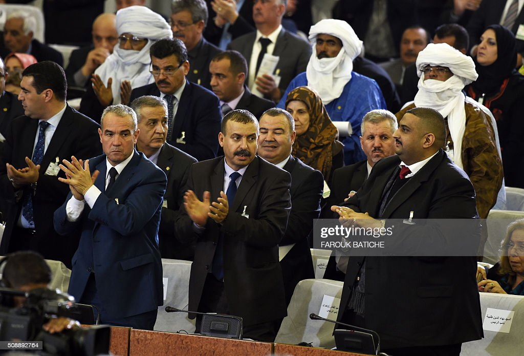 Algerian parliamentary group leaders applaud during a vote on a package of constitutional reforms on February 7, 2016, in the capital Algiers. Algeria's parliament adopted the constitutional reforms that authorities say will strengthen democracy, but opponents doubt it will bring real change. The reforms are meant to address longstanding public grievances in the North African nation, and possibly to prepare for a smooth transition amid concerns over the health of 78-year-old President Abdelaziz Bouteflika. / AFP / Farouk Batiche
