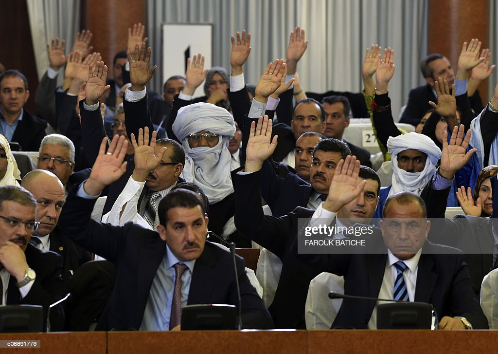 Algerian parliamentary group leaders vote on a package of constitutional reforms on February 7, 2016, in the capital Algiers. Algeria's parliament adopted the constitutional reforms that authorities say will strengthen democracy, but opponents doubt it will bring real change. The reforms are meant to address longstanding public grievances in the North African nation, and possibly to prepare for a smooth transition amid concerns over the health of 78-year-old President Abdelaziz Bouteflika. / AFP / Farouk Batiche