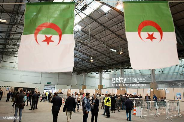 Algerian people prepare to vote at a polling station in the Chanot Park on April 12 2014 in Marseille southern France Algeria's Abdelaziz Bouteflika...