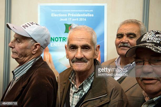Algerian people queue to vote at a polling station in the Chanot Park on April 12 2014 in Marseille southern France Algeria's Abdelaziz Bouteflika...