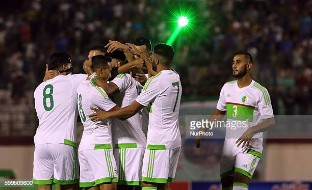 Algerian players celebrate after scoring a goal against Lesotho at the 2017 African Cup of Nations soccer qualifying match between Algeria and...