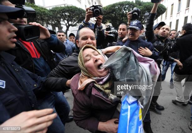 Algerian police arrest a demonstrator during a protest against Algerian President Abdelaziz Bouteflika running in the April presidential elections in...