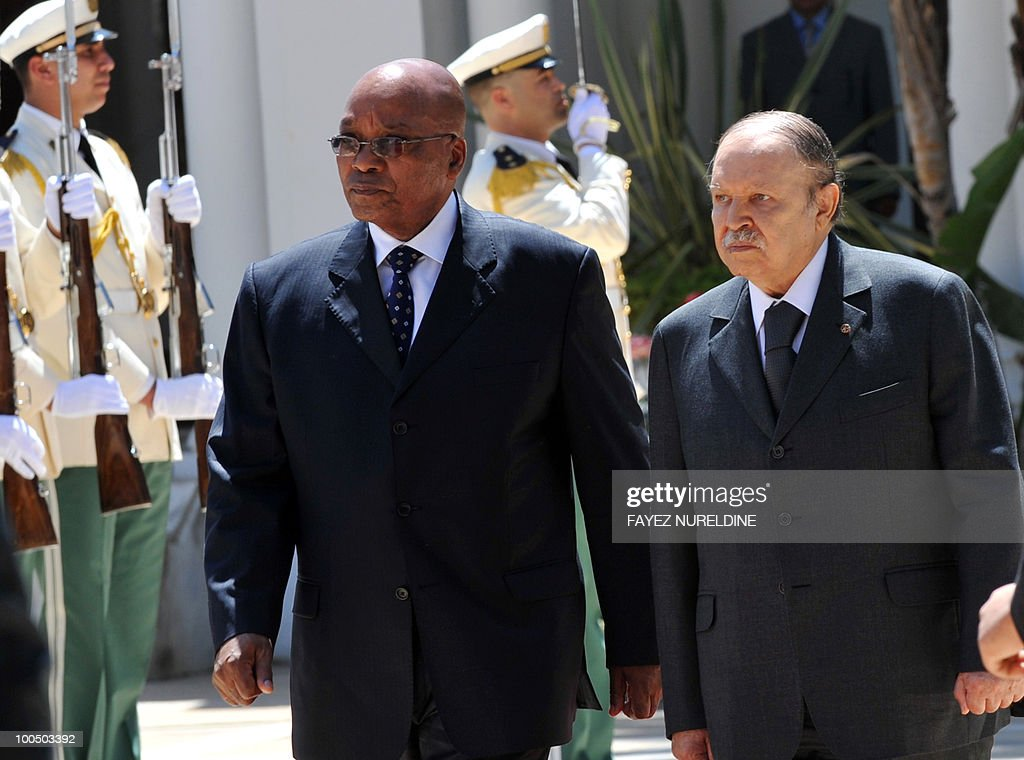 Algerian President Abdelaziz Bouteflika (R) and his South African counterpart Jacob Zuma review a honor guard during a welcoming ceremony at the Presidential Palace, on May 25, 2010 in Algiers. Zuma is on a two-day official visit to Algeria.