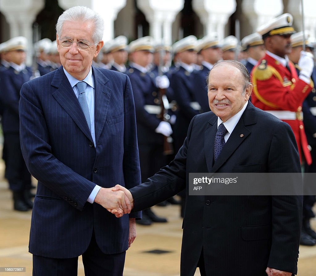 Algerian President Abdelaziz Bouteflika (R) and Italian Prime Minister Mario Monti shake hands as they review the honour guard during a welcome ceremony on November 14, 2012 in Algiers. Monti is on an official visit to Algeria to attend an inter-governmental summit.