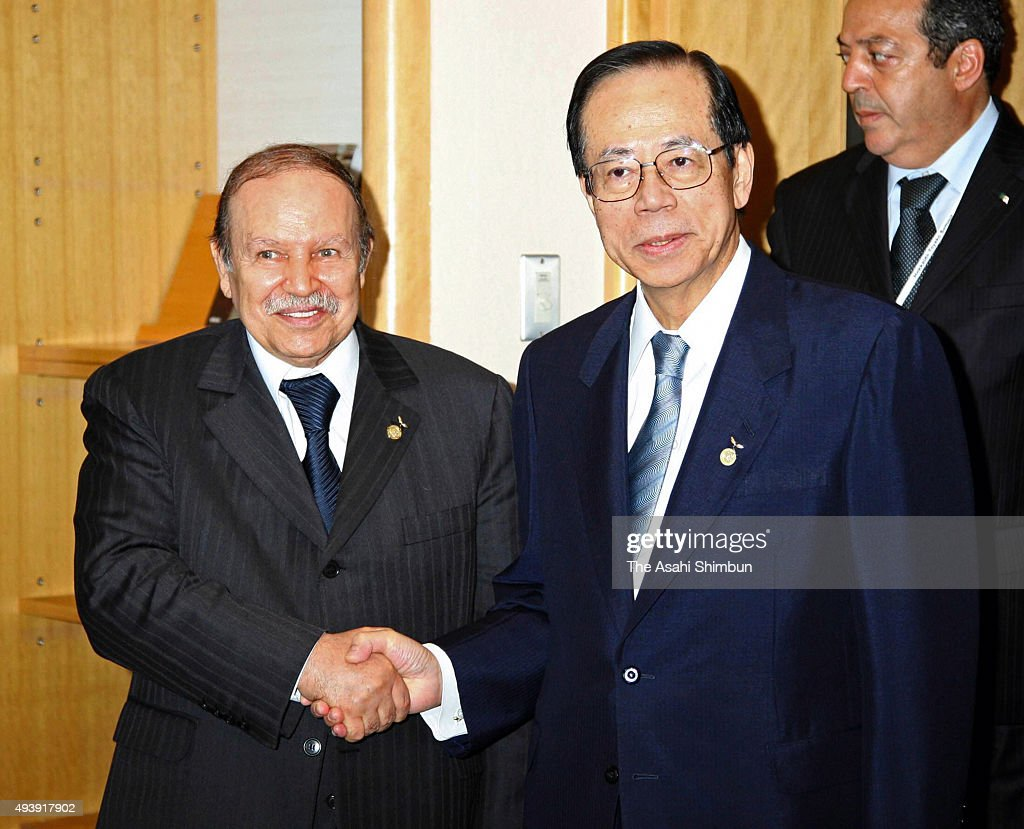 Algerian President <a gi-track='captionPersonalityLinkClicked' href=/galleries/search?phrase=Abdelaziz+Bouteflika&family=editorial&specificpeople=176720 ng-click='$event.stopPropagation()'>Abdelaziz Bouteflika</a> and Japanese Prime Minister <a gi-track='captionPersonalityLinkClicked' href=/galleries/search?phrase=Yasuo+Fukuda&family=editorial&specificpeople=2664316 ng-click='$event.stopPropagation()'>Yasuo Fukuda</a> shake hands during their meeting on the sidelines of the G8 Summit on July 7, 2008 in Toyako, Hokkaido, Japan.