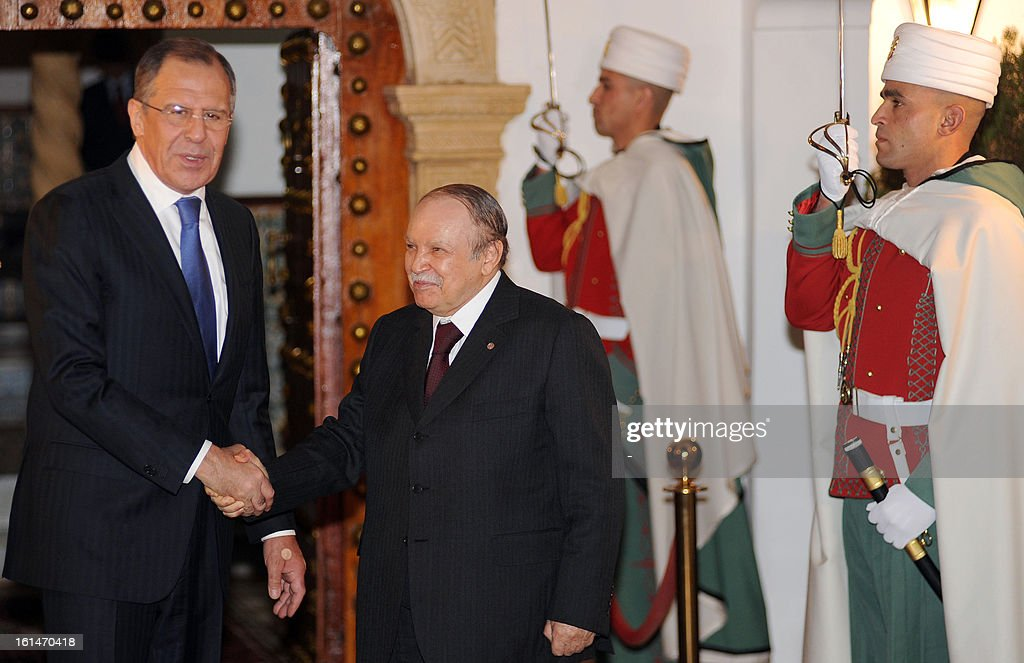 Algerian President Abdelaziz Bouteflika (R) greets Foreign Minister Sergei Lavrov in Algiers, on February 11, 2013, during an official visit.