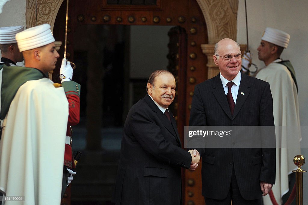 Algerian President Abdelaziz Bouteflika (L) greets the President of the Bundestag lower house of parliament Norbert Lammert in Algiers, on February 11, 2013. Lammert is on a two day official visit.