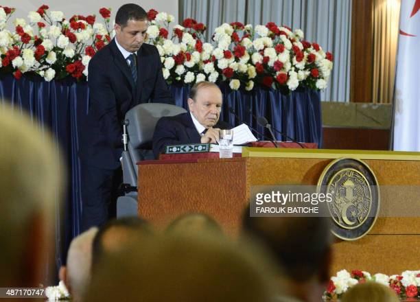 Algerian President Abdelaziz Bouteflika is pushed on the stage in his wheel chair during his inauguration ceremony as he is sworn as Algeria's...