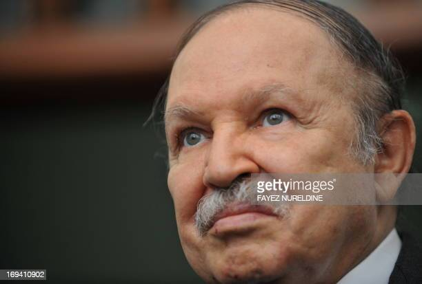 Algerian President Abdelaziz Bouteflika listens to his South African counterpart Jacob Zuma during a press conference at the Presidential Palace on...