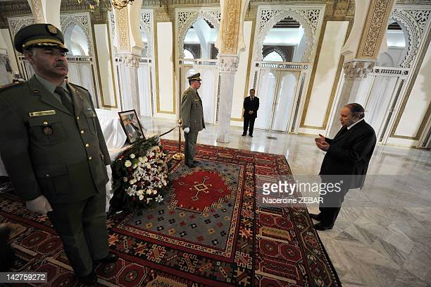 Algerian President Abdelaziz Bouteflika pays his respects at the coffin of first postindependence President Ahmed Ben Bella in the People's Palace...