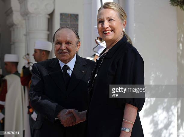 Algerian President Abdelaziz Bouteflika shakes hands with US Secretary of State Hillary Clinton upon her arrival for a meeting at the Mouradia Palace...