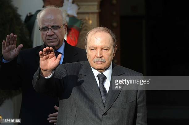 Algerian president Abdelaziz Bouteflika waves after meeting Moroccan foreign minister on January 24 2012 in Algiers Moroccan Foreign Minister Saad...