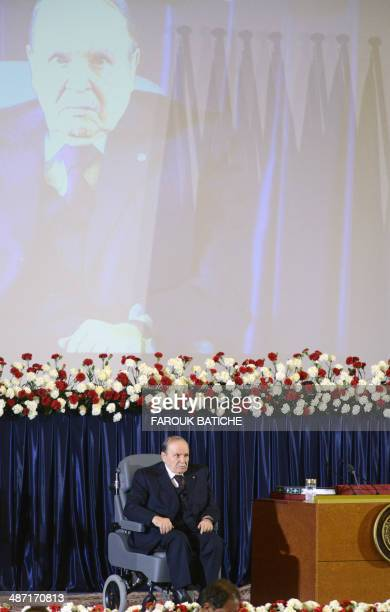 Algerian President Abdulaziz Bouteflika sits in his wheelchair on stage during his inauguration ceremony as he is sworn as Algeria's President for a...