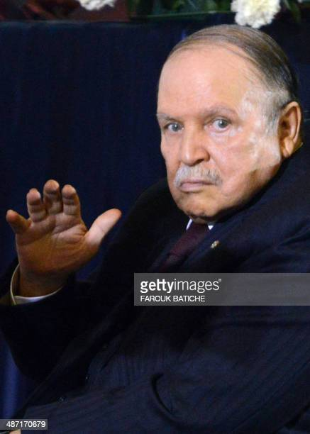 Algerian President Abdulaziz Bouteflika waves during his inauguration ceremony as he is sworn as Algeria's President for a fourth term in Algiers on...