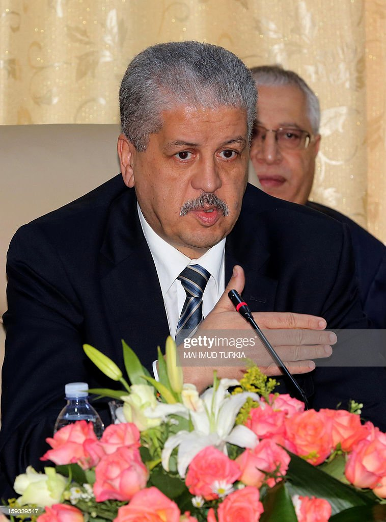 Algerian Prime Minister Abdelmalek Sellal addresses a three-way summit with his Libyan and Tunisian counterparts (not seen) in the Libyan oasis of Ghadames on January 12, 2013. The tripartite meeting is being held to discuss security along their common borders. AFP PHOTO/MAHMUD TURKIA