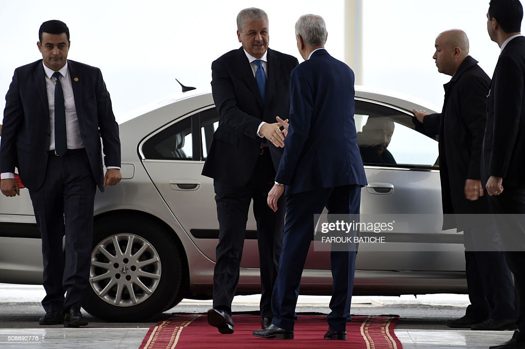 Algerian Prime Minister Abdelmalek Sellal (C-L) arrives at a parliamentary session to adopt a package of constitutional reforms on February 7, 2016, in the capital Algiers. Algeria's parliament adopted the constitutional reforms that authorities say will strengthen democracy, but opponents doubt it will bring real change. The reforms are meant to address longstanding public grievances in the North African nation, and possibly to prepare for a smooth transition amid concerns over the health of 78-year-old President Abdelaziz Bouteflika. / AFP / Farouk Batiche