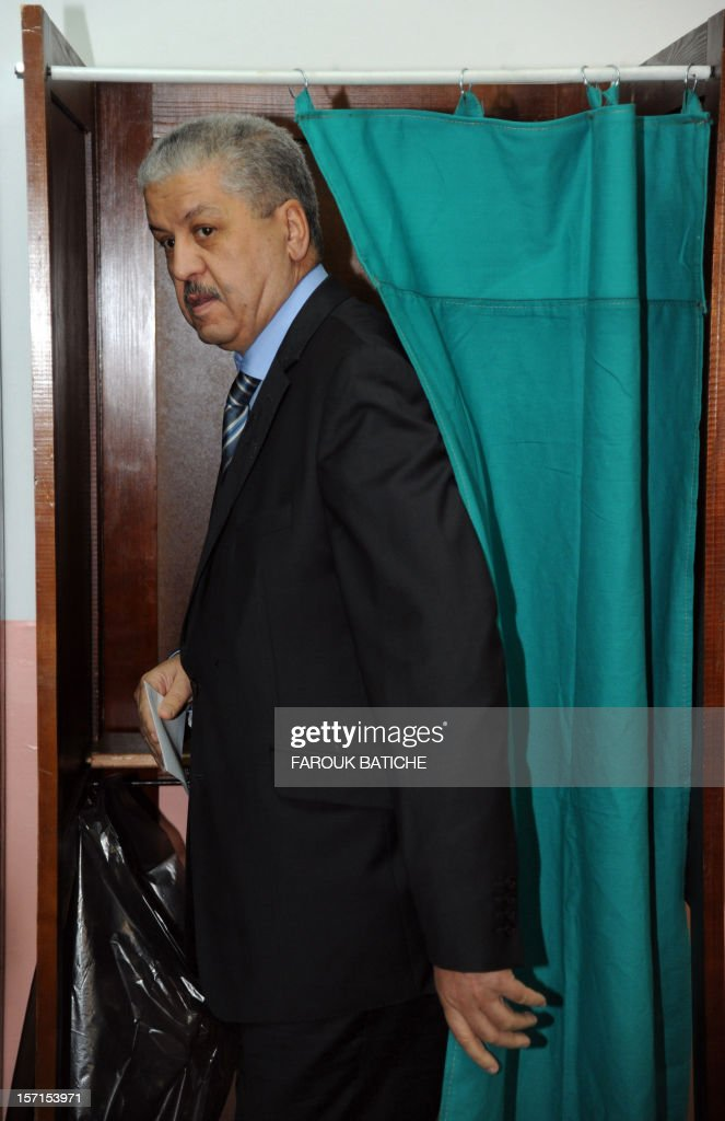 Algerian Prime Minister Abdelmalek Sellal casts his vote at a polling station, set up at the El-Ghazali school in Algiers, during local elections on November 29, 2012. Algeria's ruling party is eyeing a landslide victory in local elections, with numerous opposition groups warning of fraud in a poll that could struggle to mobilise a disaffected electorate.