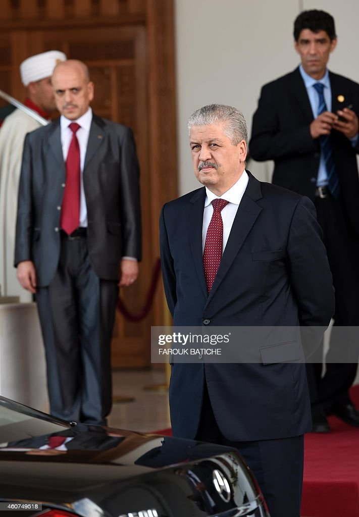 Algerian Prime Minister Abdelmalek Sellal waits before welcoming Palestinian president Mahmud Abbas upon his arrival at Houari Boumediene Airport outside the capital Algiers on December 21, 2014. Abbas is on a three-day official visit and he is expected to meet several officials.