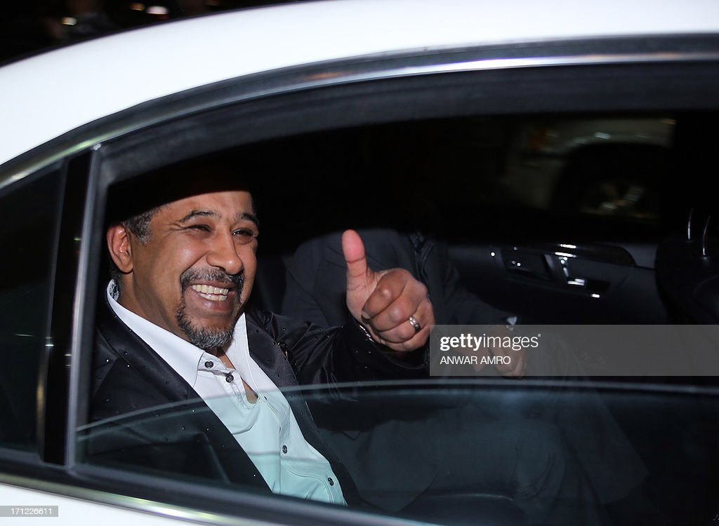 Algerian rai singer Cheb Khaled gives the thumbs-up as he arrives for the 13eme Murex D'or Festival taking place at the Casino Du Liban, north of the capital Beirut, on June 23, 2013.