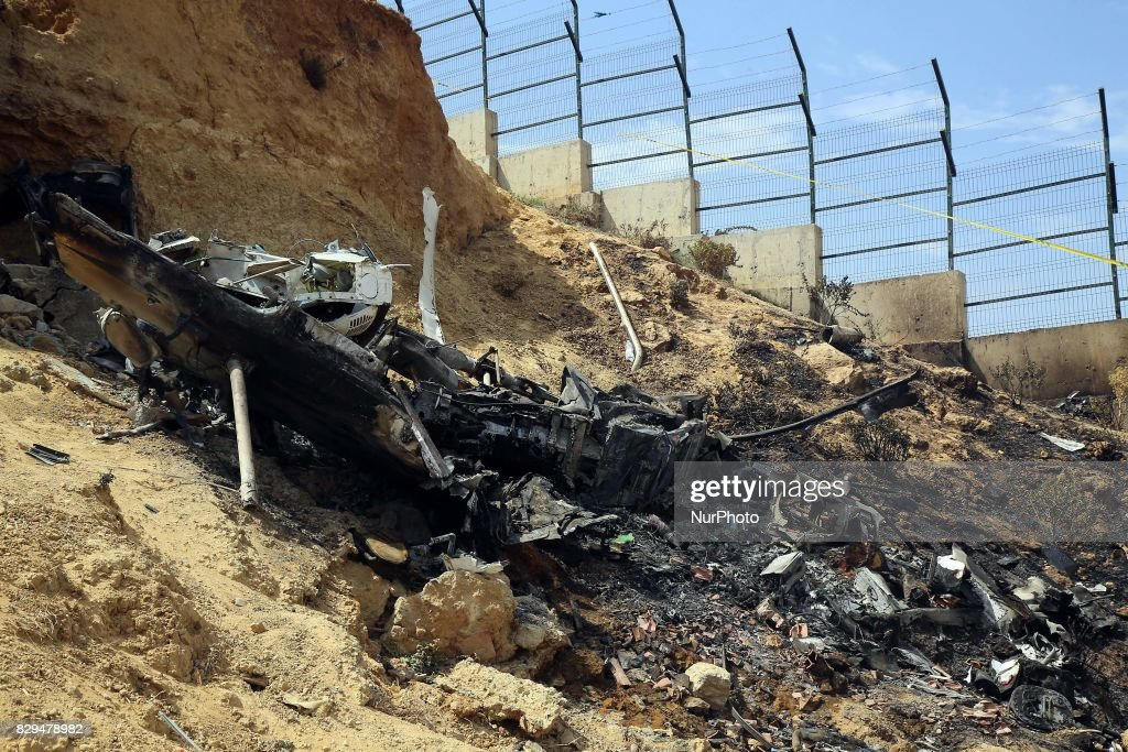 Algerian rescue workers inspect the site of a helicopter crash, Bel 206, belonging to Tassili Airlines, which killed four people, on August 10, 2017, in Douera, 20 km southwest of Algiers.