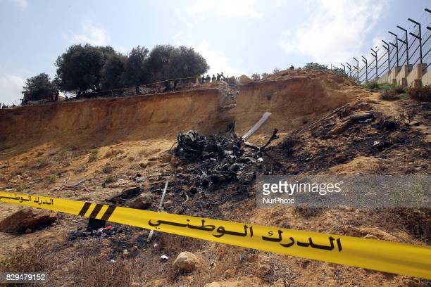Algerian rescue workers inspect the site of a helicopter crash Bel 206 belonging to Tassili Airlines which killed four people on August 10 in Douera...