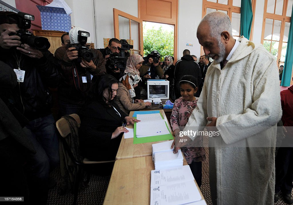 Algerian secretary general of the National Liberation Front (FLN) Abdelaziz Belkhadem (R), casts his vote at a polling station, set up at the El-Ghazali school in Algiers, during local elections on November 29, 2012. Algeria's ruling party is eyeing a landslide victory in local elections, with numerous opposition groups warning of fraud in a poll that could struggle to mobilise a disaffected electorate.