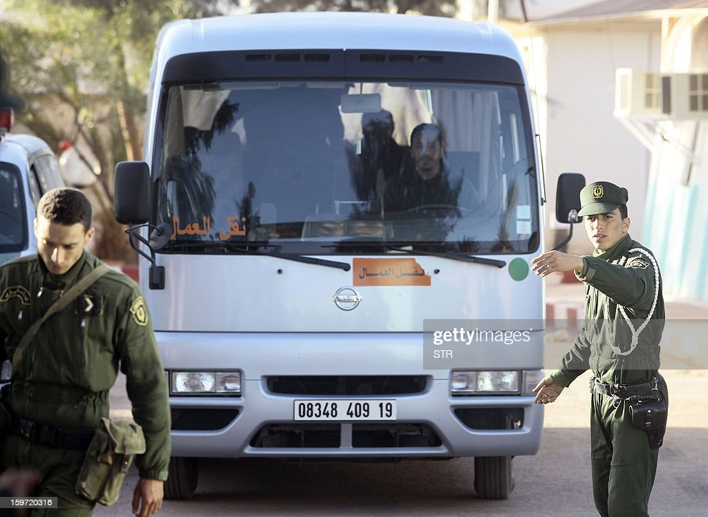 Algerian security forces escort a bus carrying freed hostages outside a police station in In Amenas in the desert in Algeria's deep south on January 19, 2013. Islamists killed all seven of their remaining foreign captives before being gunned down at a gas plant in the Algerian desert, state media said, ending one of the bloodiest international hostage crises in years. AFP PHOTO/STR