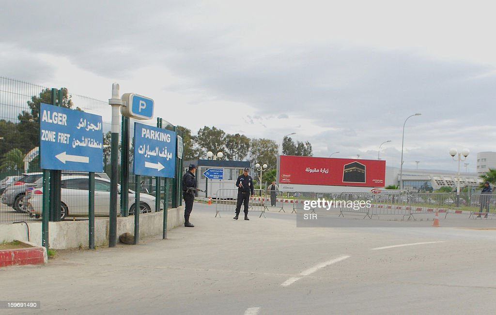 Algerian security forces stand guard at the entrance of the parking lot of Algiers International Airport on January 18, 2013 as Islamist hostage-takers at a remote Algerian gas field demanded a prisoner swap and an end to the French military campaign in Mali, a report said, while 30 foreigners were reported still missing in the worst international hostage drama for years.