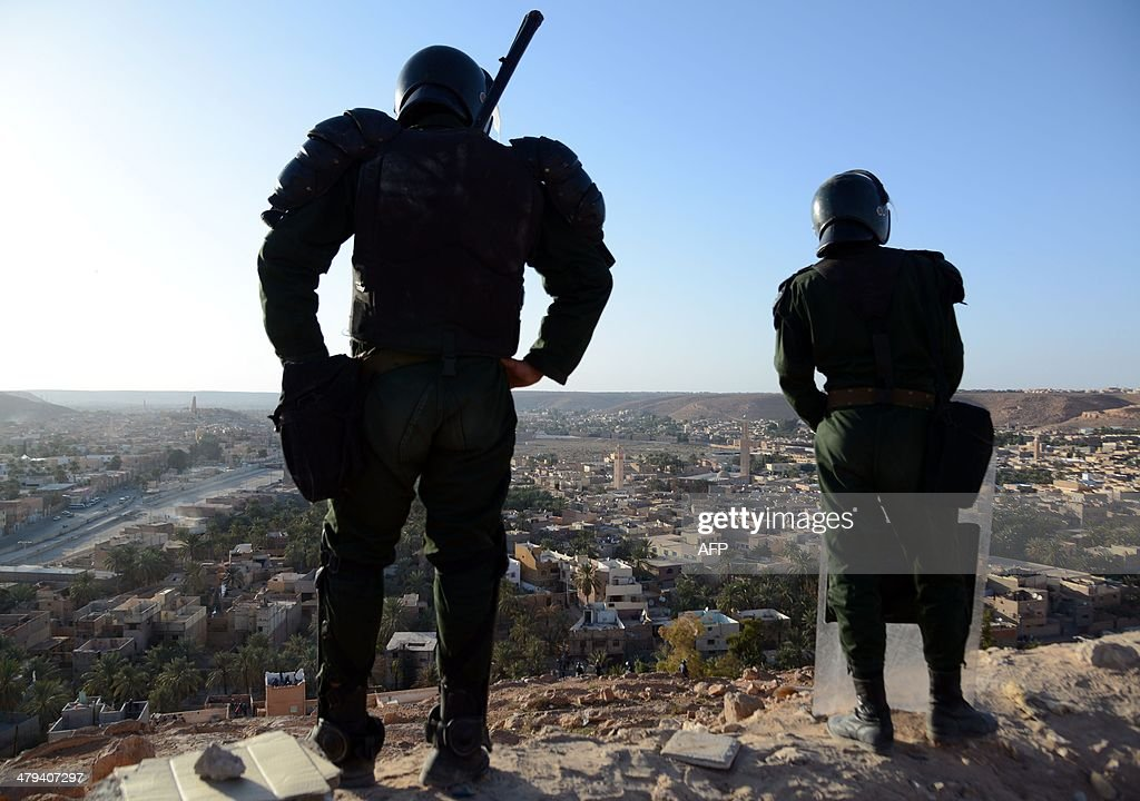 Algerian security forces stand guard on a ridge looking down on the Algerian city of Ghardaia on March 18, 2014 during an operation to secure the city following sectarian clashes. The city of 90,000 inhabitants has been rocked since December by clashes between the Chaamba community of Arab origin and the majority Mozabites, indigenous Berbers belonging to the Ibadi Muslim sect.