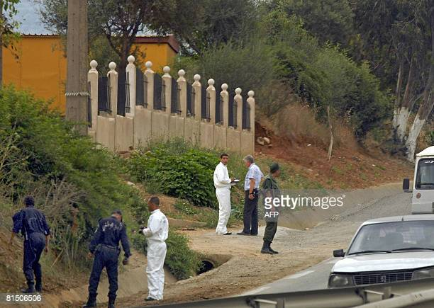 Algerian security men stand near the site of the blast that killed a French engineer near Beni Amrane some 80 kms east of Algiers on June 09 2008 A...