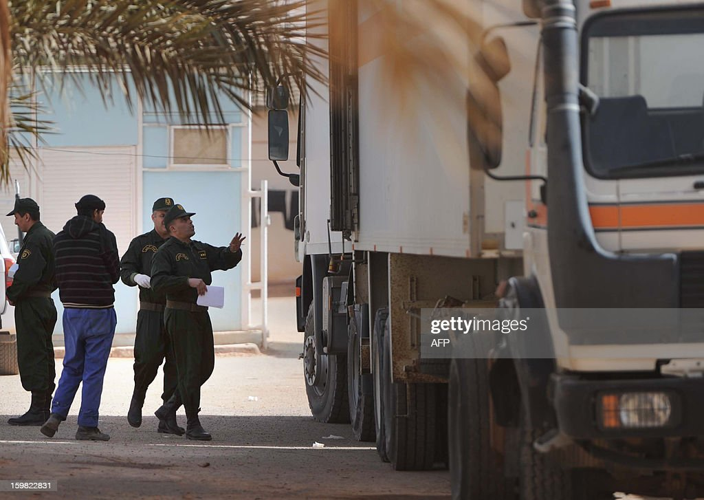 Algerian security personnel monitor as they remove body bags of victims, that were killed during the hostage crisis at a desert gas plant in Algeria's deep south, from refrigerated trucks that are transporting the bodies to hospital for identification in In Amenas on January 21, 2012. Two days after Algerian forces ended a hostage crisis at a desert gas plant, the exact toll of those killed in the bloodbath remained unknown, amid fears the total number of hostages who died could reach 50.