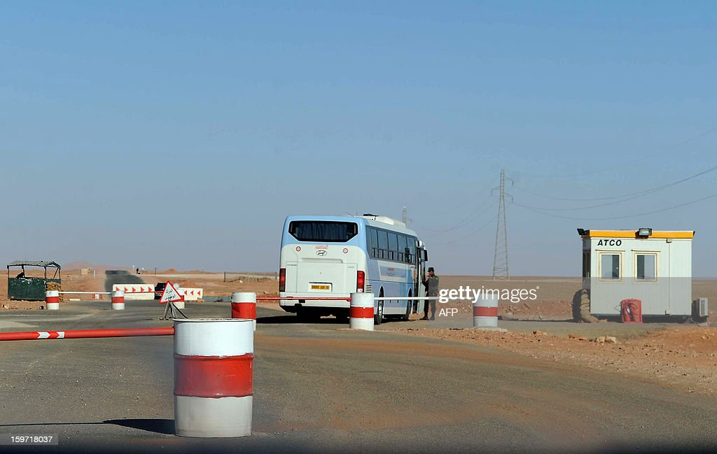 Algerian soldiers man a checkpoint near In Amenas deep in the Sahara near the Libyan border on January 19, 2013. Islamist gunmen killed seven foreign hostages in Algeria before being gunned down by special forces in a final assault on a remote desert gas complex, state television said.