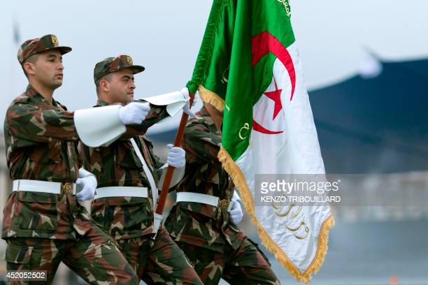 Algerian soldiers parade on July 12 2014 on the Champs Elysees avenue in Paris during a rehearsal of the French national celebration the Bastille Day...
